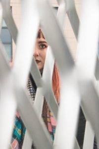 Woman looking through screen